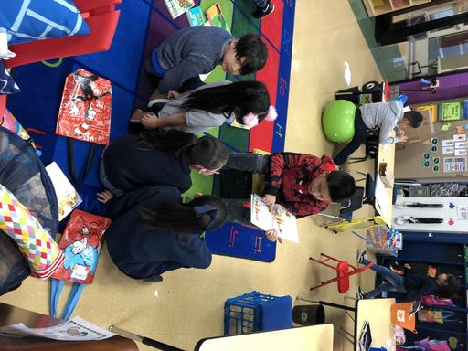 6th grader reads to kindergarten
