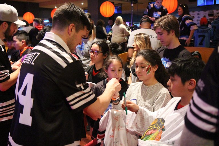 Celebrating inner-city education: D99 students mingle with Blackhawks players at downtown bowling alley